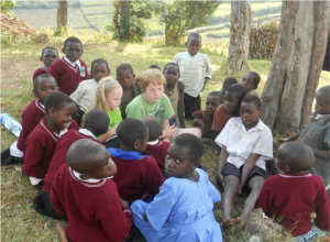 Johnson's children accompanied her in the field, often drawing considerable attention. Here they are during data collection with the Batwa ethnic group in Southwest Uganda.